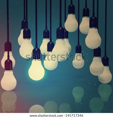 creative idea and leadership concept light bulb as vintage style concept - stock photo