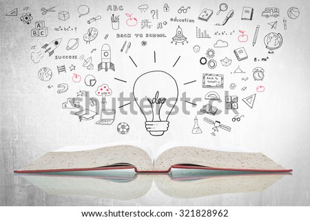 Creative idea light bulb over open textbook w/ reflection and freehand doodle sketch drawing of educational knowledge & wisdom flowing on grey cement concrete chalkboard background: Innovative concept - stock photo