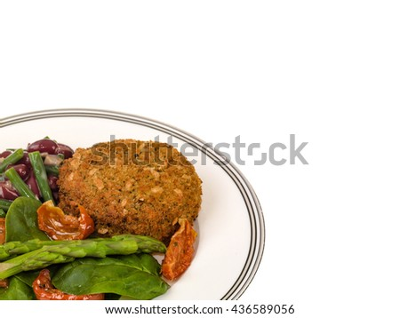 Creative Image of a Veggie Burger with Asparagus and Salad Isolated Against a White Background With Copy Space - stock photo
