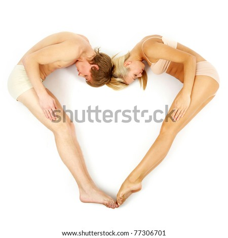 Creative image of couple lying and forming heart over white background - stock photo