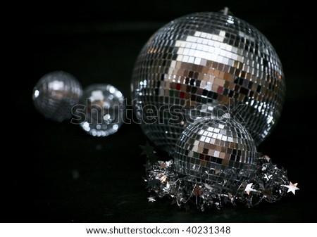 Creative image of disco balls on a black background - stock photo