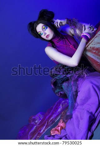 Creative lady.Young woman in dramatic image and with red and black artistic visage.