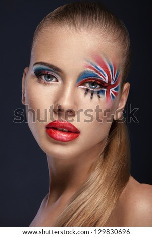 Creative make-up beauty portrait british flag on face - stock photo