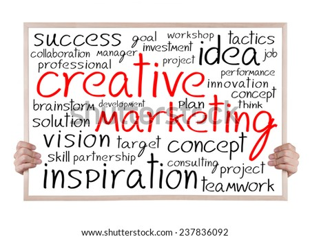 creative marketing and other related words handwritten on whiteboard with hands - stock photo