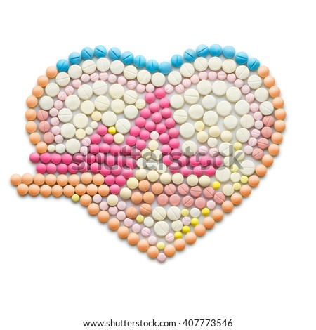 Creative medicine and healthcare concept made of drugs and pills, isolated on white. ECG, a human heart with a heartbeat line. - stock photo