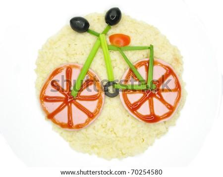 creative millet porridge garnish with sausage bicycle shape - stock photo