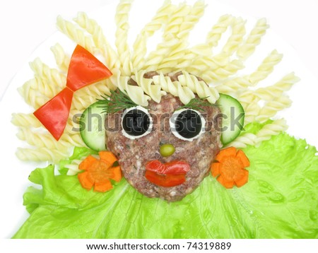 creative millet porridge garnish with sausage face shape - stock photo