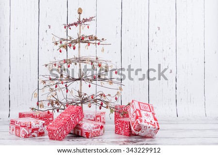 creative natural handmade christmas tree with gifts - stock photo