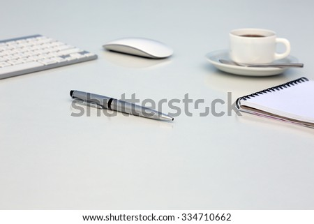 Creative Office Bright Table with Computer Keyboard Mouse Notepad and Executive Pen and Coffee Mug Side View with Reflections and Copy Space - stock photo