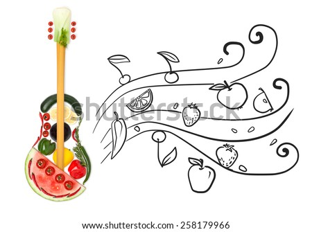 Creative photo of a standing guitar made of vegetables and fruits on grey sketchy background of flowing fruity notes. - stock photo