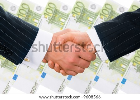 Creative photo of businesspeople handshake on the background of hundred euro banknotes - stock photo