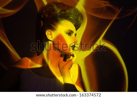 creative portrait, fashion woman with color image on her face