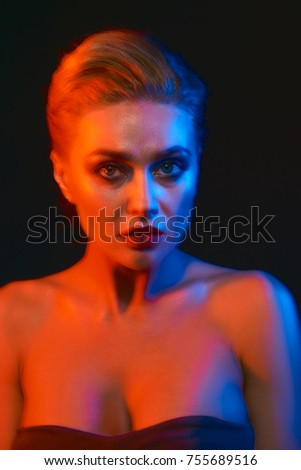 Creative portrait of a young woman with multi-exposure. Blonde. Studio portrait.