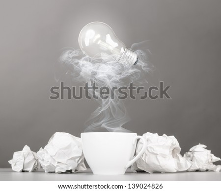creative process. crumpled wads and cup on gray - stock photo