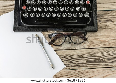creative process of writing a new masterpiece bestselling writer literature. Typewriter and blank empty white paper for your test copyspace.  Top view work table - stock photo