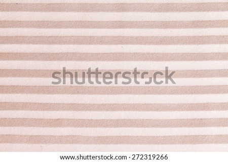 Creative sand background with abstract pattern of alternating lines of beige and golden sand in a repeat full frame pattern suitable as a design template and copy space - stock photo