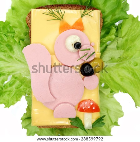 creative sandwich with cheese and salami squirrel form - stock photo
