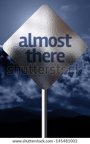 Creative sign with the message - Almost There - stock photo