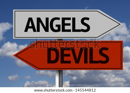 Creative sign with the message - Angels, Devils - stock photo