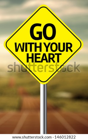 Creative sign with the message - Go With Your Heart - stock photo