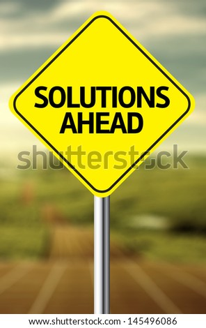 Creative sign with the message - Solutions Ahead - stock photo