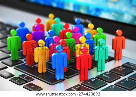 Creative social media, internet communication and business marketing corporate web concept: macro view of group of 3D color people figures on laptop or notebook keyboard with selective focus effect - stock photo