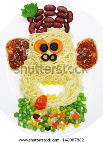 creative spaghetti food garnish with sausage monkey shape - stock photo