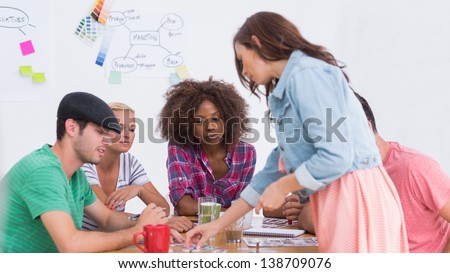 Creative team having brainstorming session in their office - stock photo