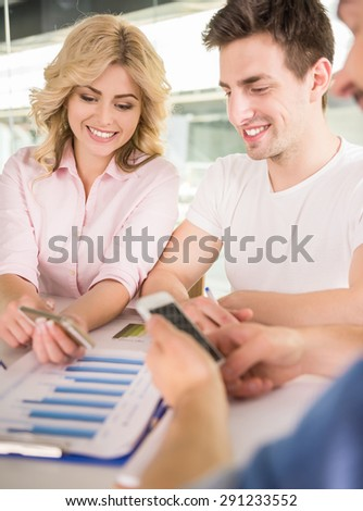 Creative team sitting at office and sharing new business ideas. - stock photo