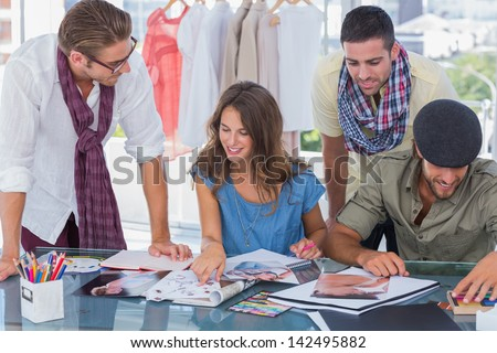 Creative team working together in a modern office - stock photo