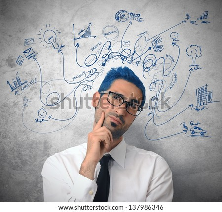 Creative thinking businessman with business symbol - stock photo