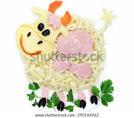 creative vegetable food meal with spaghetti cow form - stock photo