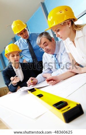 Creative view of worker team discussing design project - stock photo