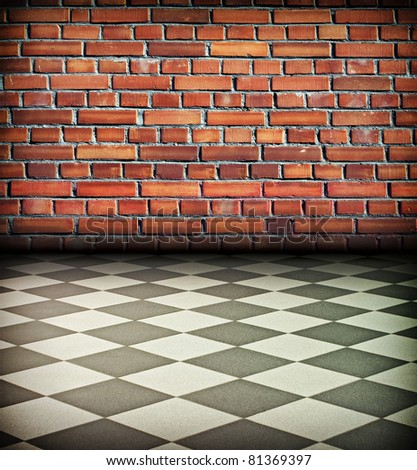 creative vintage interior with brick wall and chess tile floor - stock photo