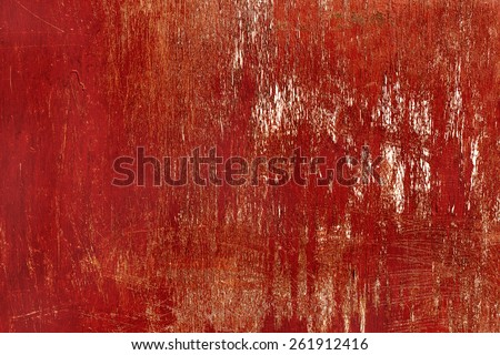 Creative wooden surface with scratches painted bright red. Textured background for your concept or project. Great background or texture. - stock photo