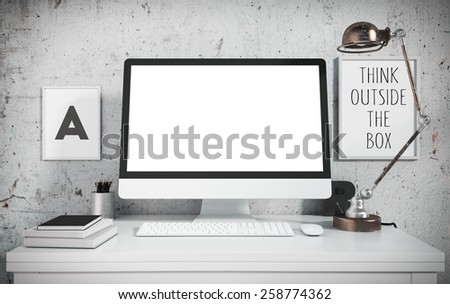 Creative workspace with retro lamp, books, posters and computer standing on a table. 3D rendering - stock photo