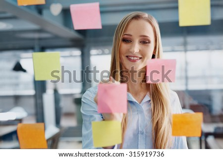 Creative young woman working at office planning company strategy - stock photo