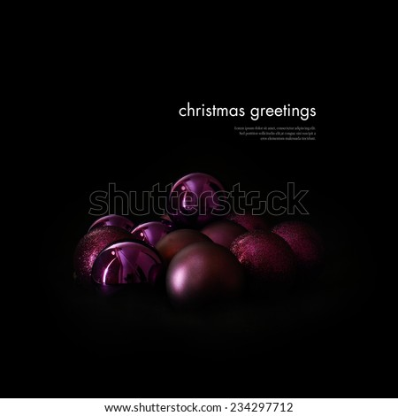 Creatively lit festive Christmas decorations against a black background. Copy space. - stock photo
