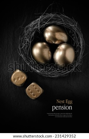 Creatively lit stylish concept image for pension nest egg or investment. Golden eggs placed in a birds nest with golden dice against black slate. Copy space. - stock photo