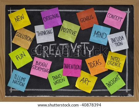 creativity concept - related cloud of words, color sticky notes and white chalk handwriting on blackboard - stock photo