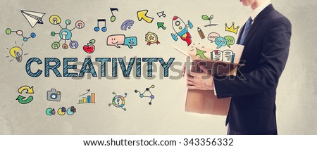 Creativity concept with businessman holding a cardboard box - stock photo