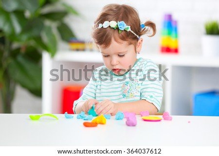 creativity of childrens. child girl sculpts from clay - stock photo