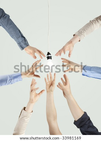 creativity, teamwork and energy concept - stock photo
