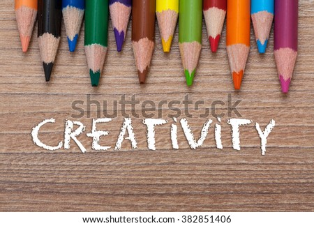Creativity words - Concept frame of multicolored pensils on wood background - stock photo