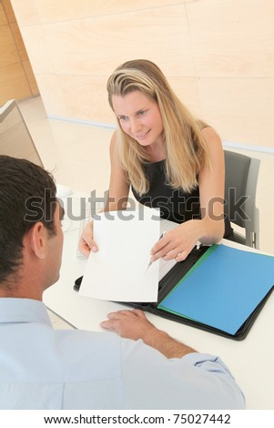 Credit adviser showing document to buyer - stock photo