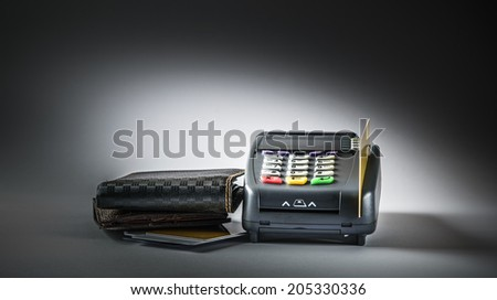 Credit card and card reader machine with lighting effect - stock photo