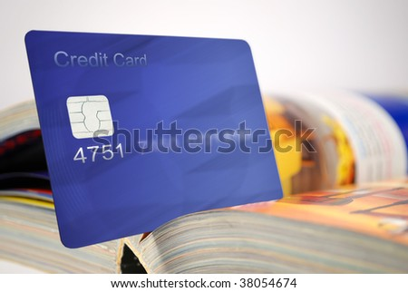 credit card and catalog for shopping - stock photo