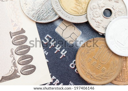 Credit card and currency - stock photo