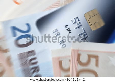 Credit card and Euro banknotes with zoom effect