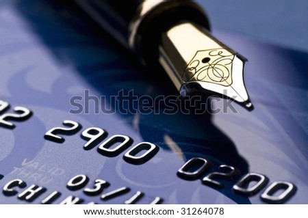 credit card and ink pen - stock photo
